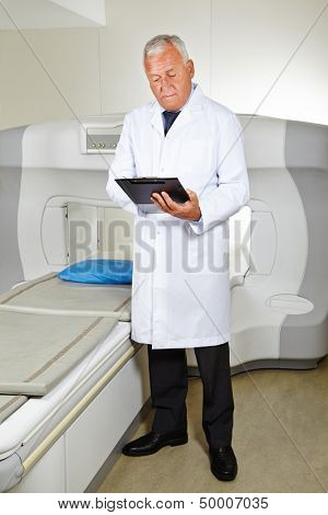 Doctor with clipboard and checklist at MRI in radiology in a hospital
