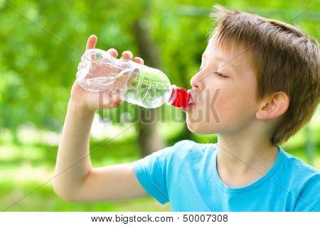 Boy Drinks Water