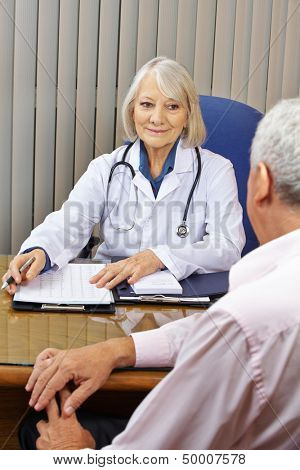 Doctor at a consultation with patient in her office