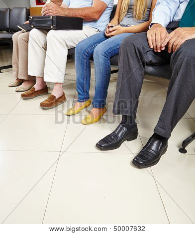 Group of patients sitting in waiting room of a doctor