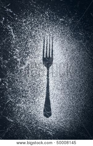 Kitchen fork imprint made with icing sugar
