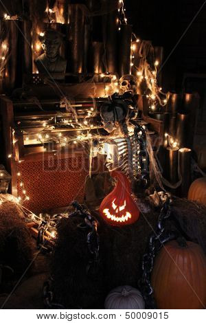 Skeleton and pumpkins in a dark setting for Halloween