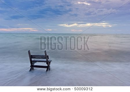 Chair on the sea sand with long speed shutter... lonely and waiting