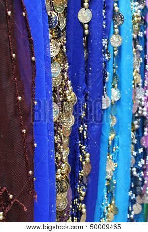 Colorful details of belly dancer's skirts