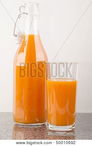 Carrot Juice In A Glass And A Bottle