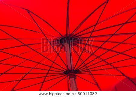 Under red asian umbrella structure