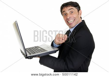 Fun portrait of a mature businessman holding an open laptop in his hand turning and giving a cheesy toothy grin of happiness to the camera isolated on white