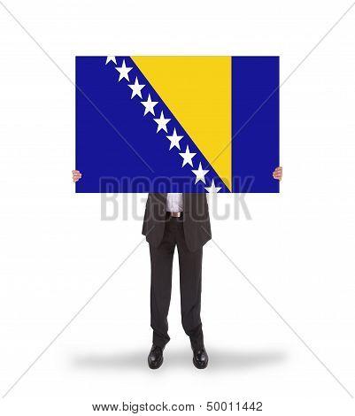 Smiling Businessman Holding A Big Card, Flag Of Bosnia And Herzegovina
