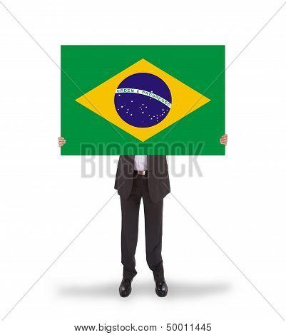 Smiling Businessman Holding A Big Card, Flag Of Brazil