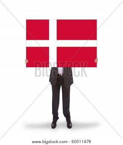 Smiling Businessman Holding A Big Card, Flag Of Denmark