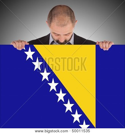 Smiling Businessman Holding A Big Card, Flag Of Bosnia And Herzegovina