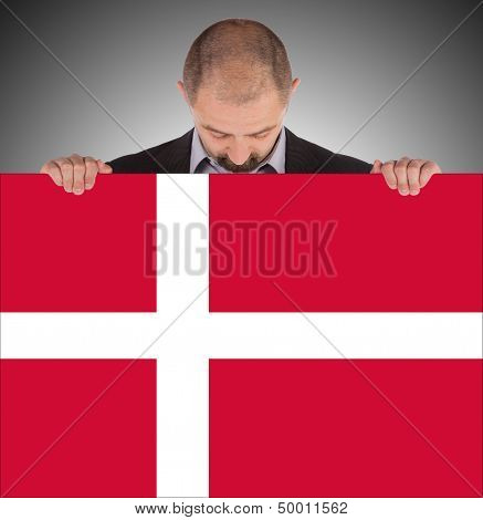 Smiling Businessman Holding A Big Card, Flag Of Denmark