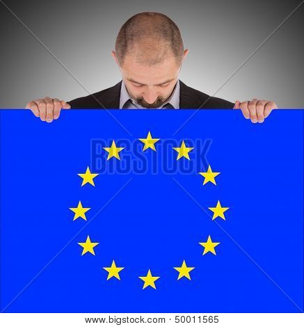Smiling Businessman Holding A Big Card, Flag Of The European Union