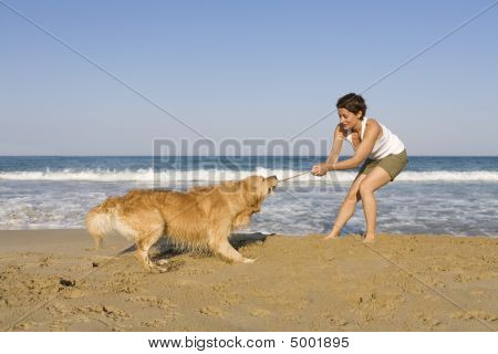 Beautiful young girl playing with her dog poster