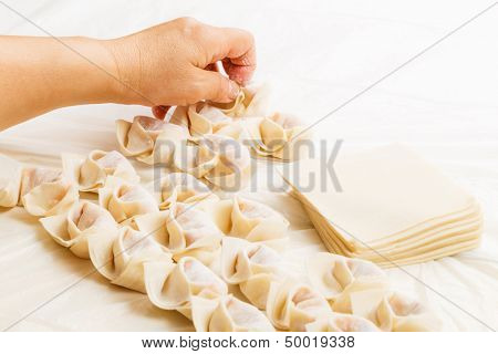 Homemade dumpling with human hand