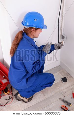Female electrician with a voltmeter