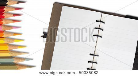 Blank Open Note Book And Hot Tone Color Pencil