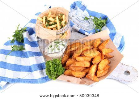Home potatoes on tracing paper on wooden board near napkin isolated on white