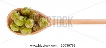 Gooseberry in wooden spoon isolated on white