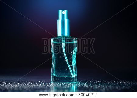 Women perfume in beautiful bottle on dark background