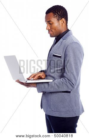 Young business man with a laptop computer isolated over a white background