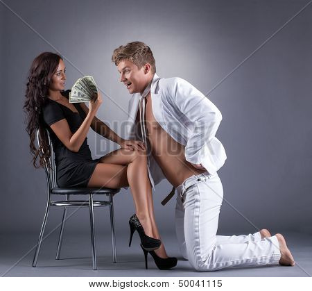 Sexy young girl flirting with dancer, close-up