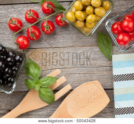 Fruits, vegetables and utensils on wooden table