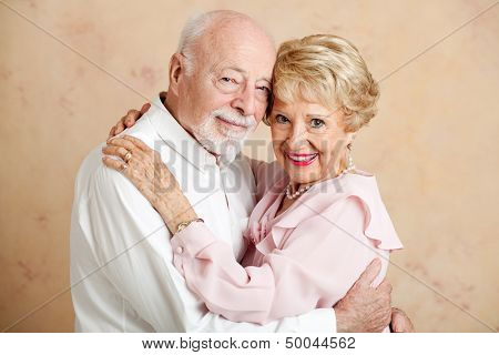 Portrait of beautiful couple in their eighties, still in love.