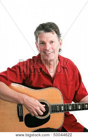 Mature musician playing his guitar against a white background.
