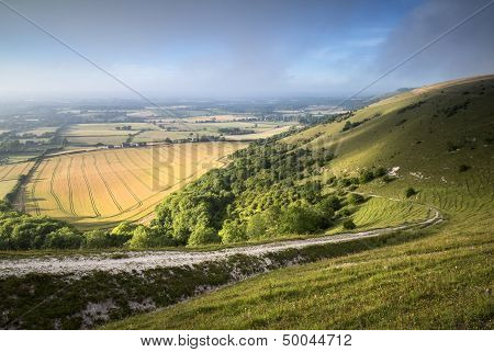 View Across English Countryside Landscape During Late Summer Evening With Dramatic Natural Lighting