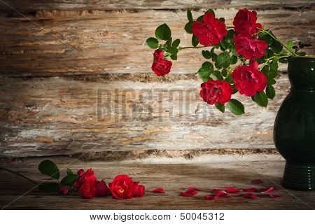 Still Life With A Blooming Branch Of Rose