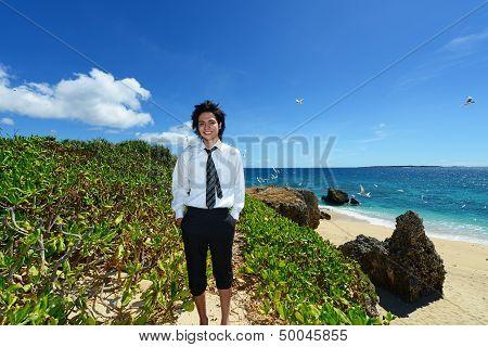 Young man on the beach enjoy sunlight