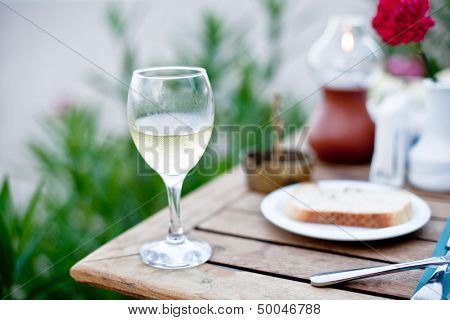 Glass of white wine on a celebratory table.