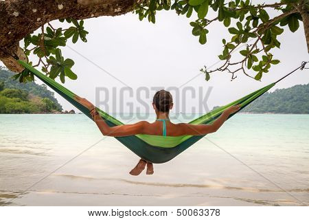 young woman relaxing in a hammock