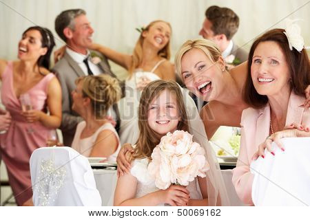 Bride With Grandmother And Bridesmaid At Wedding Reception