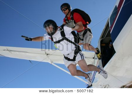 Two Skydivers Exits A Plane