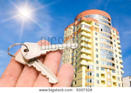 Gold Keys With House On Blue Sky