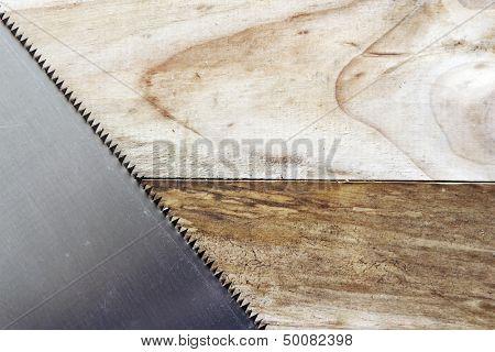 Saw blade teeth on wood.