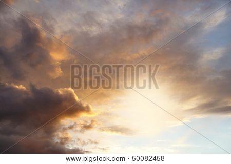 Sun rays in sunset sky