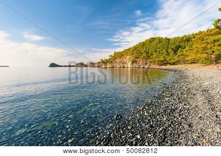 Sea bay with clear calm water on a sunny day