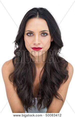 Gorgeous sexy brunette posing on white background