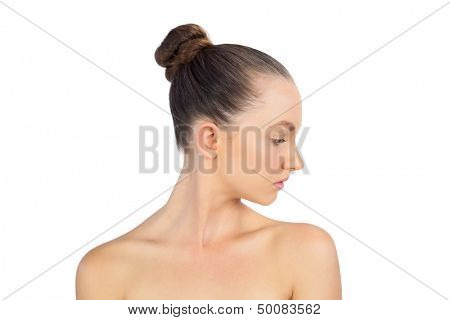 Young attractive model posing against a white background
