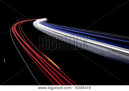 Light Trails On Motorway At Night.