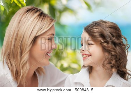 parenting and motherhood concept - happy mother and daughter