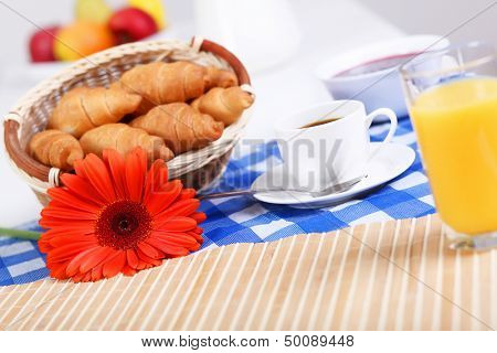 Continental breakfast with croisant and black coffee poster