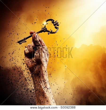 Key in human hand. Struggle and success