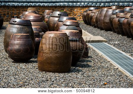 Traditional Korean kimchi jars  for preseving kimchi poster