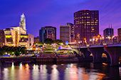 The skyline of downtown Hartford, Connecticut at dusk from across the Connecticut River. poster