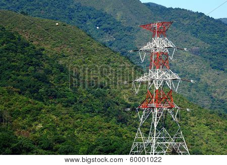 Power distribution tower on mountain
