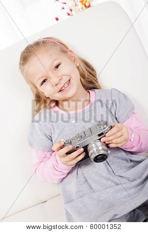 Little girl with a retro camera